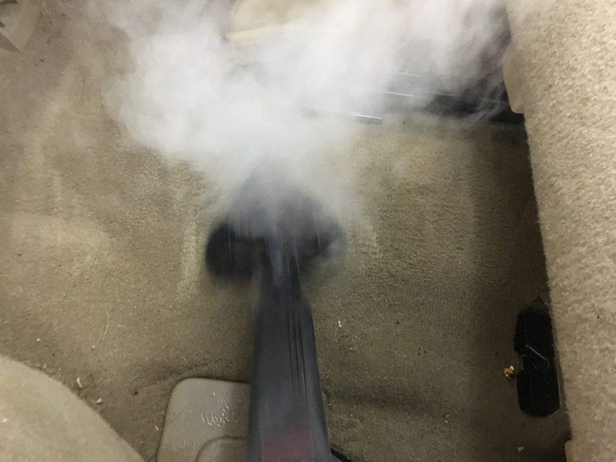 Steam cleaning car carpet